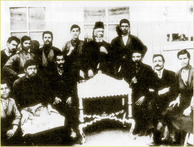 The jeweler Fila with his coworkers who made the table of gold and silver, a gift from the Munici pality to the sultan Reshad V, filmed at front of the store of artisan Fila, (1911)
